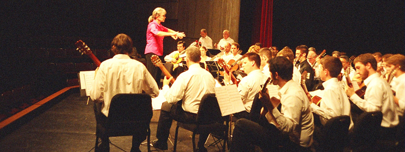 Anne Wilson conducting guitar choir